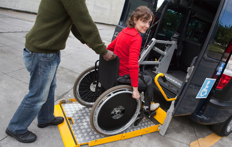 Woman using accessible taxi