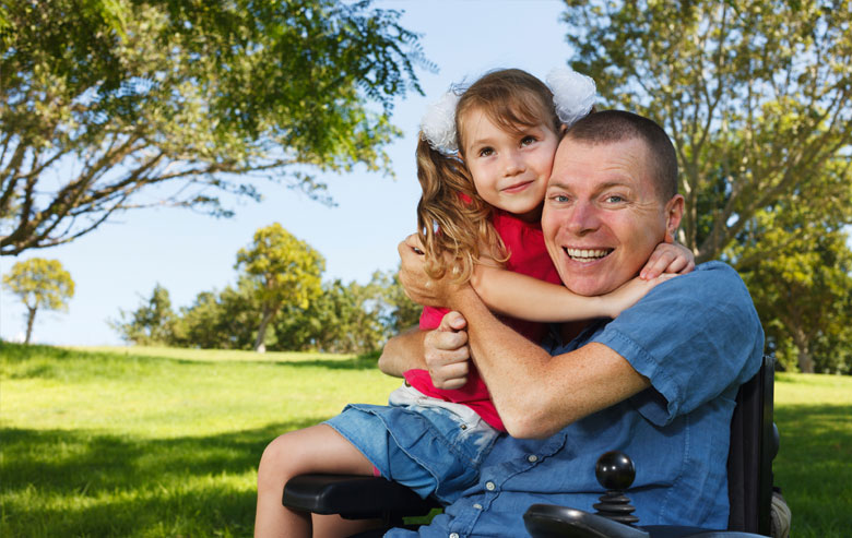 Man in wheelchair with daughter