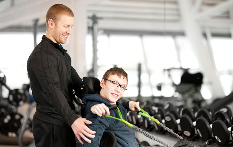 Stock_Young man exercising in gym
