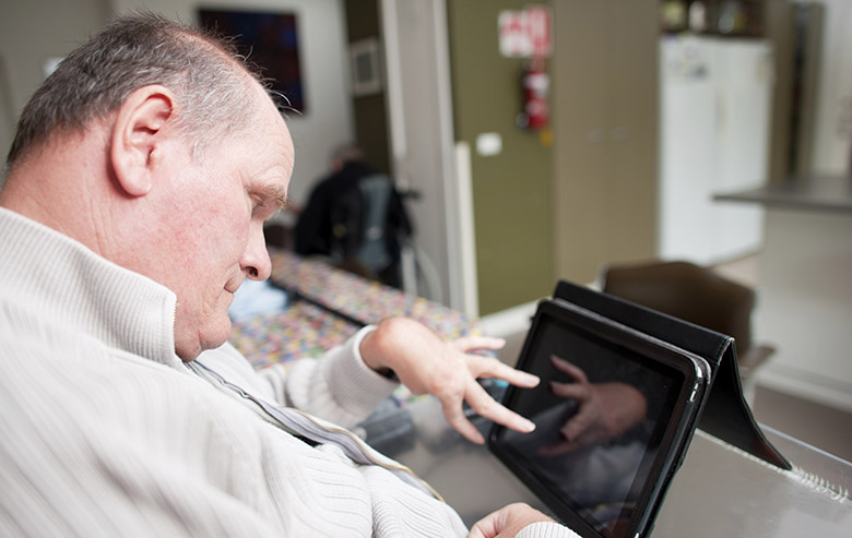 Man with disability using an ipad
