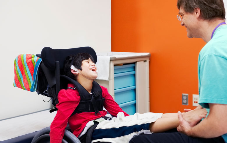 Boy in wheelchair with doctor