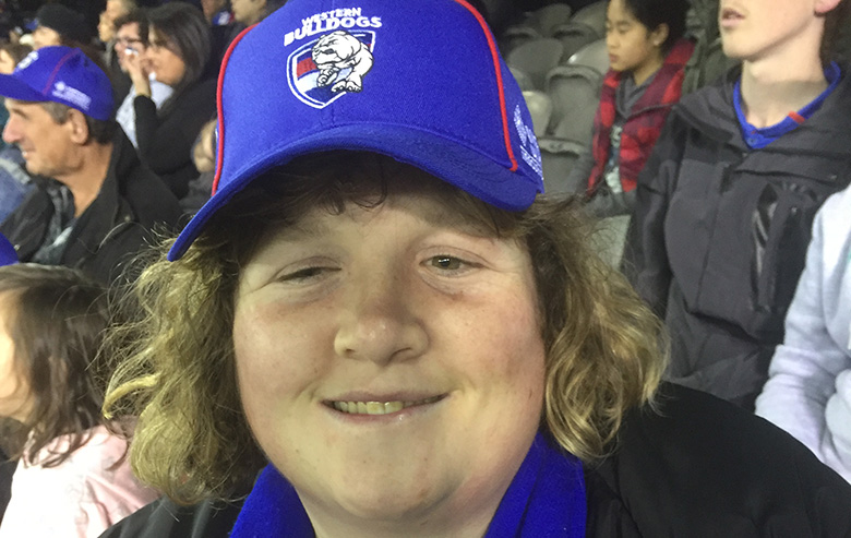 Anna sitting in crowd at Western Bulldogs game